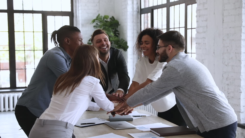 Successful male leader unite happy multiracial team people stack hands on table together promising support trust in partnership, help in collaboration, professional leadership concept, slow motion Royalty-Free Stock Footage #1044100564