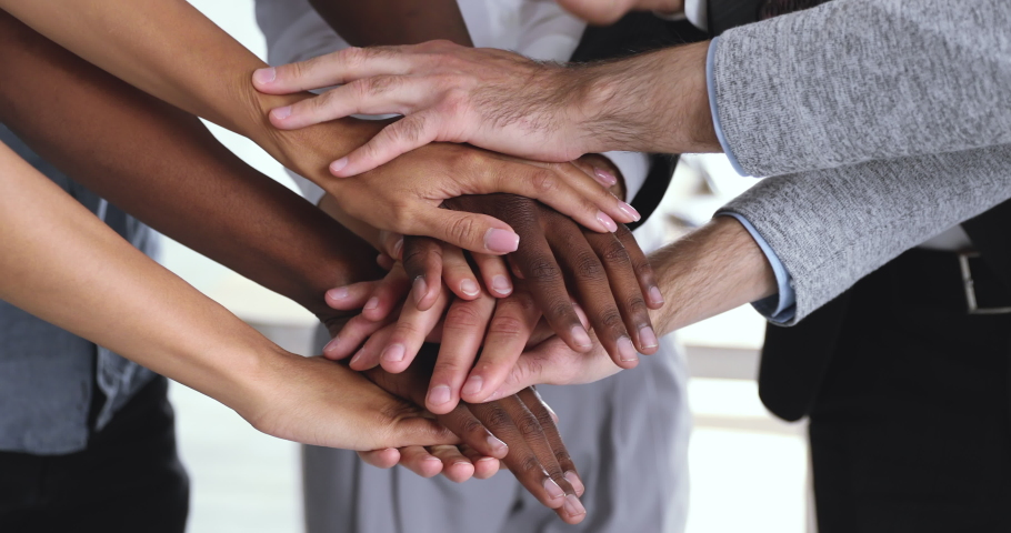 Corporate business team people group stack hands together in pile close up view building strong reliable team helping in teamwork express strength power of partnership professional leadership concept Royalty-Free Stock Footage #1044100702