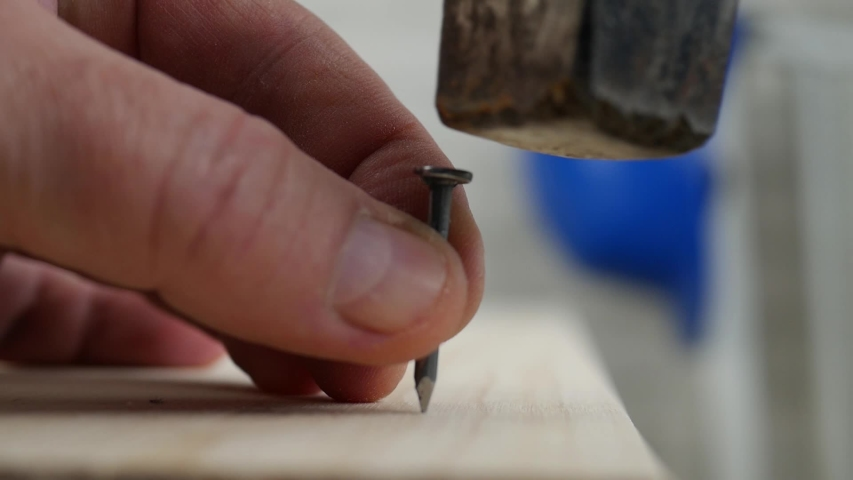 Worker Mistake Trying to Fix a Plank with a Nail and a Hammer | Shutterstock HD Video #1044161146
