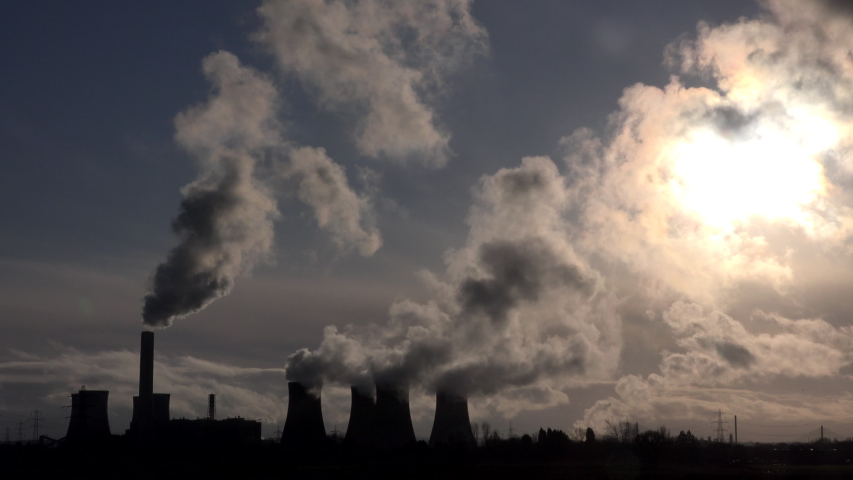 Coal fired power station pumping out smoke and steam. Global warming pollution in Manchester England UK 4K