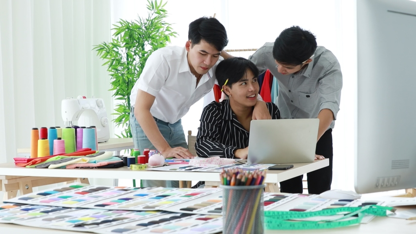 Group of Asian handsome male fashion designer is selecting the material for sewing as a dress for the fashion show of the new collection.  | Shutterstock HD Video #1044188407