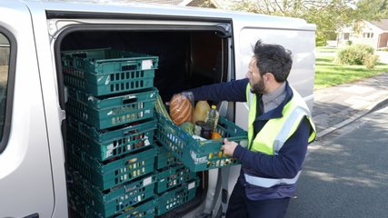 Grocery delivery driver from Supermarket lifts crate of food out of the van - Online order  -4K Stock Video clip footage