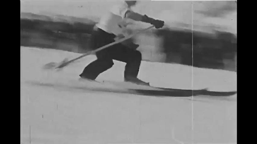 CIRCA 1935 - Spectators enjoy a men's slalom race at Mount Rainier.