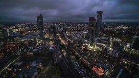 Amazing Skyline Establishing Bird Eye Aerial View Shot of Manchester UK Skyline England United Kingdom at evening night drone helicopter