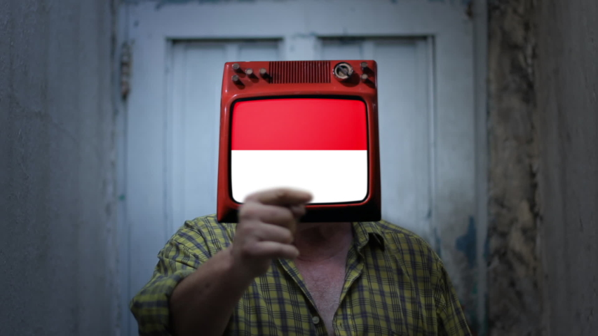 Television Man with the flag of Indonesia on the Screen. Zoom In. | Shutterstock HD Video #1044361723