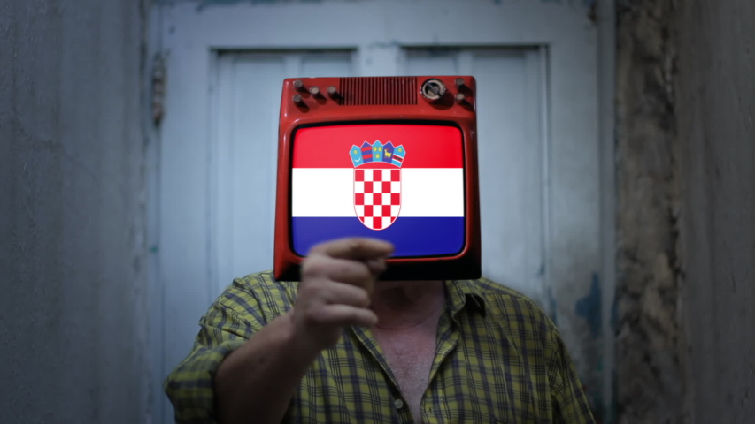 Television Man with the flag of Croatia on the Screen. Zoom In. | Shutterstock HD Video #1044371077