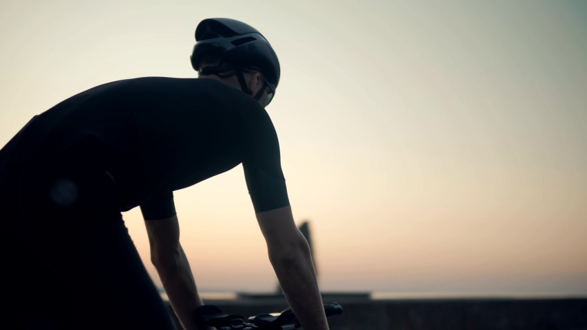 Sport Recreation Bike Cycling On Sunset Time. Cyclist In Helmet Riding On Sunset.Triathlon Time Trial Bicycle.Triathlete Training Endurance Cycling Race.Fit Cyclist Cardio Workout On Triathlon Bike | Shutterstock HD Video #1044373603