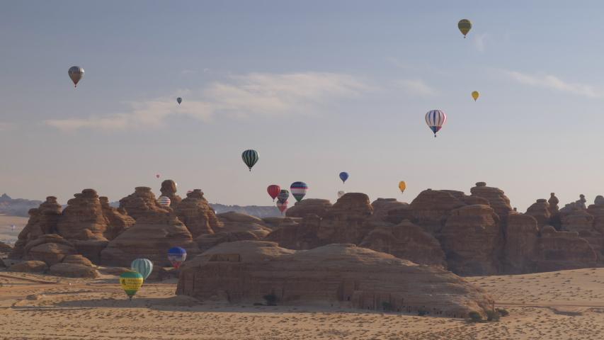 Winter at Tantora Festival, January 3, 2020. Hot Air Balloons fly over Mada'in Saleh (Hegra) ancient archeological site near Al Ula, Saudi Arabia