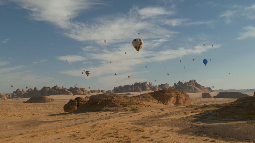 Winter at Tantora Hot Air Balloon Festival over Mada'in Saleh (Hegra) ancient archeological site near Al Ula, Saudi Arabia