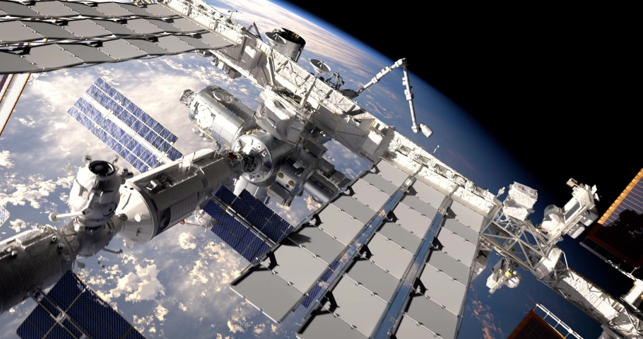 Flight of International Space Station ISS orbiting the blue marble planet Earth. Fly above the planet atmosphere. 3D animation. Elements of this image furnished by NASA.