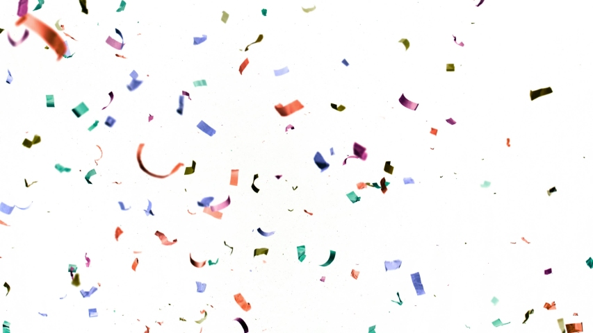 Super slow motion of flying coloured confetti isolated on white background. Filmed on high speed cinema camera.