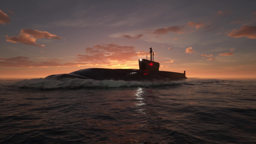 Submarine floating in ocean at sunset