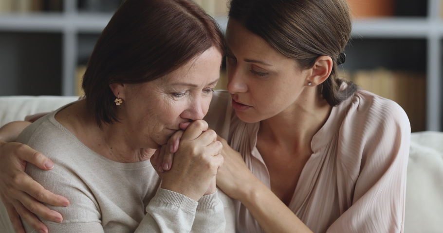Caring worried guilty young adult daughter apologizing comforting sad depressed old mother say sorry feel pity regret consoling upset senior mom ask for forgiveness hug giving empathy support concept | Shutterstock HD Video #1044454891