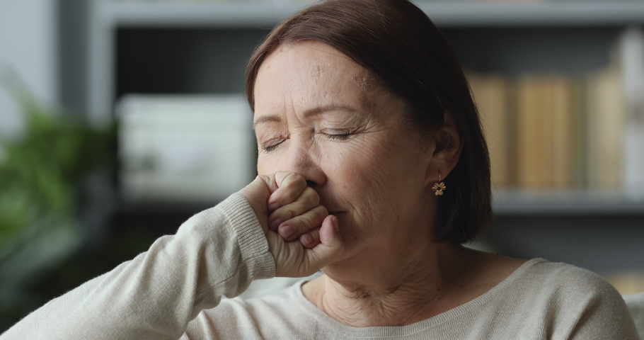 Thoughtful sad worried middle aged elder woman looking away think of loneliness grief sorrow concept, serious depressed old mature grandma lost in thought feel concerned alone at home, close up view Royalty-Free Stock Footage #1044454894