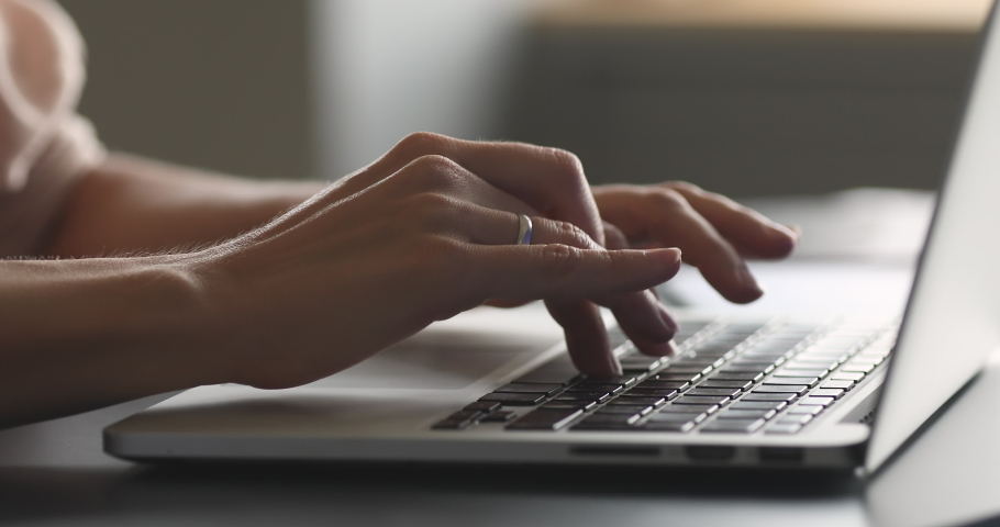 Female hands of business woman professional user worker using typing on laptop notebook keyboard sit at home office desk working online with pc software apps technology concept, close up side view Royalty-Free Stock Footage #1044454993