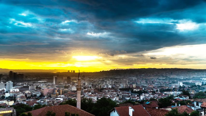 Timelapse of the sun shining through dark clouds in Ankara city, Turkey