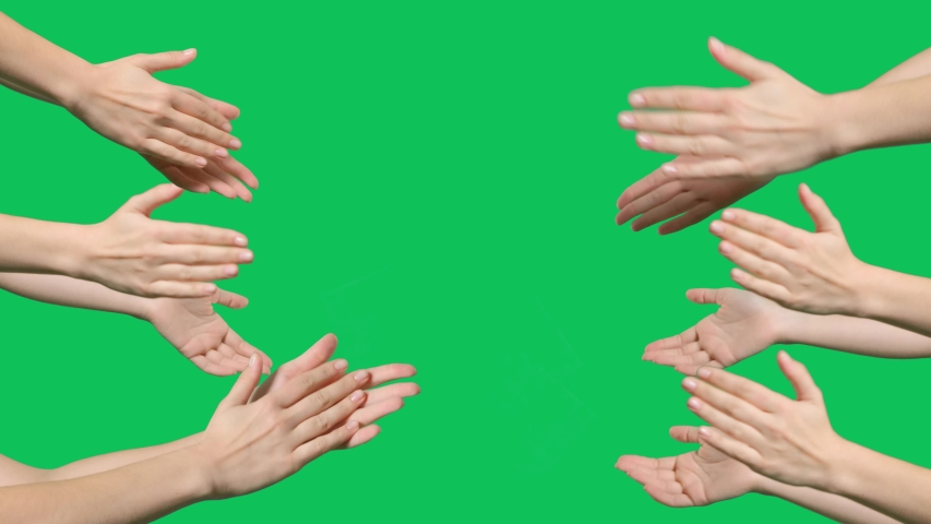 Hands are clapping on green screen background. Female hands silhouette clapping on a chroma key background
