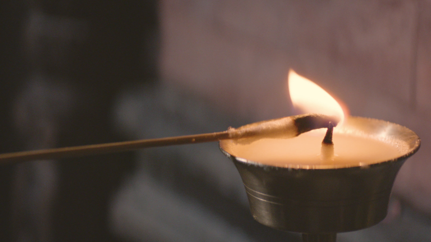 Nepalese candle gets lit up | Shutterstock HD Video #1044487744