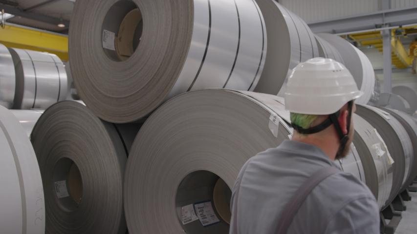 Man Walking through steel coils | Shutterstock HD Video #1044508324