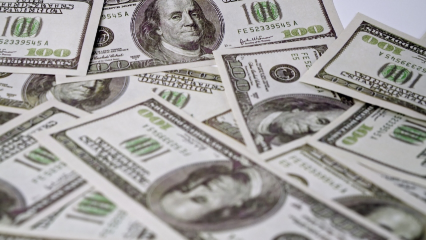 American one hundred dollar paper money pile on office desk. Concept of finance and money payment. | Shutterstock HD Video #1044539080