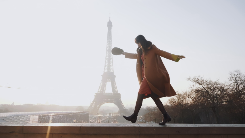 Side view beautiful happy woman doing fun dance walk at romantic sunset Eiffel Tower sky panorama in Paris slow motion. | Shutterstock HD Video #1044540508