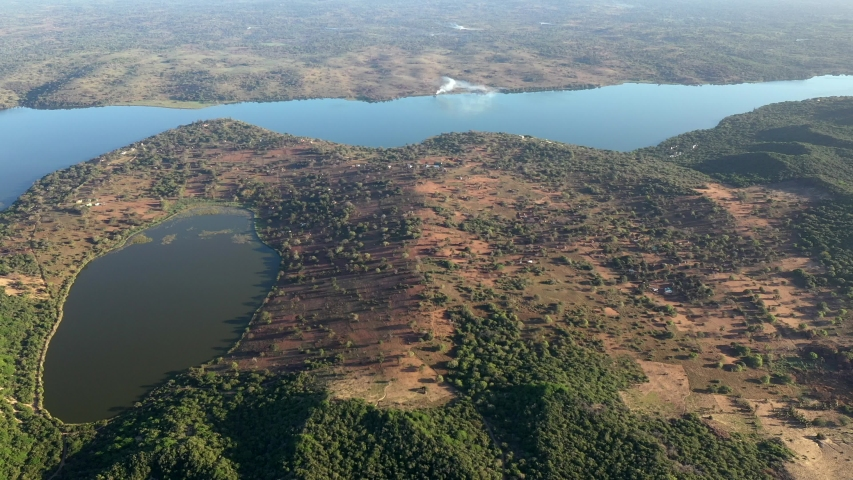 High Altitude Forward Flying Shot of Inhampavala Lake in Chindeguele Mozambique During Golden Hour Sunrise Royalty-Free Stock Footage #1044552859