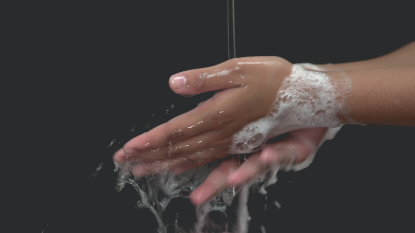 Close up of female lathering hands with soap before washing   | Shutterstock HD Video #1044579097