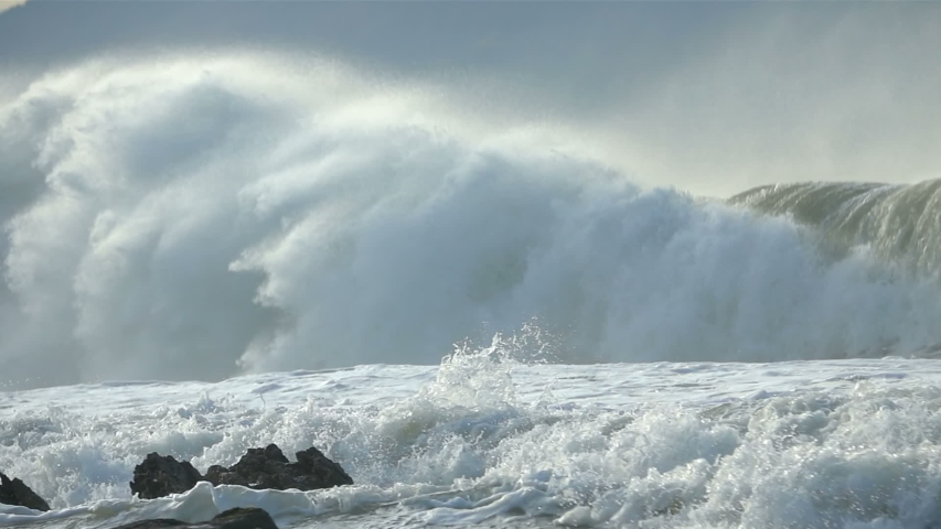 Extreme Ocean Wave crushing coast. Power of waves breaking splashing sea-spray water foam  Royalty-Free Stock Footage #1044601696