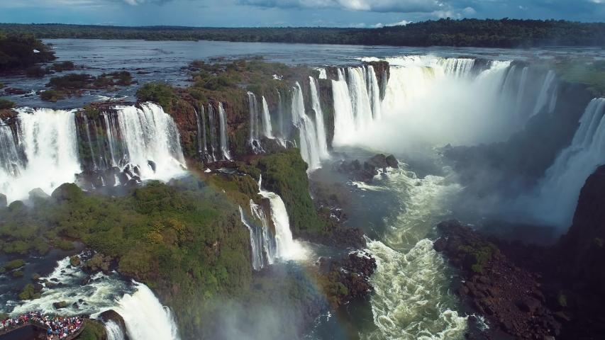 Aerial landscape of Iguazu waterfalls. Niagara waterfalls. Cataratas del Iguazu waterfall. Waterfalls nature scene. Rainbow water falls landscape. Aerial view of Cataratas do Iguaçu water fall stream | Shutterstock HD Video #1044615058