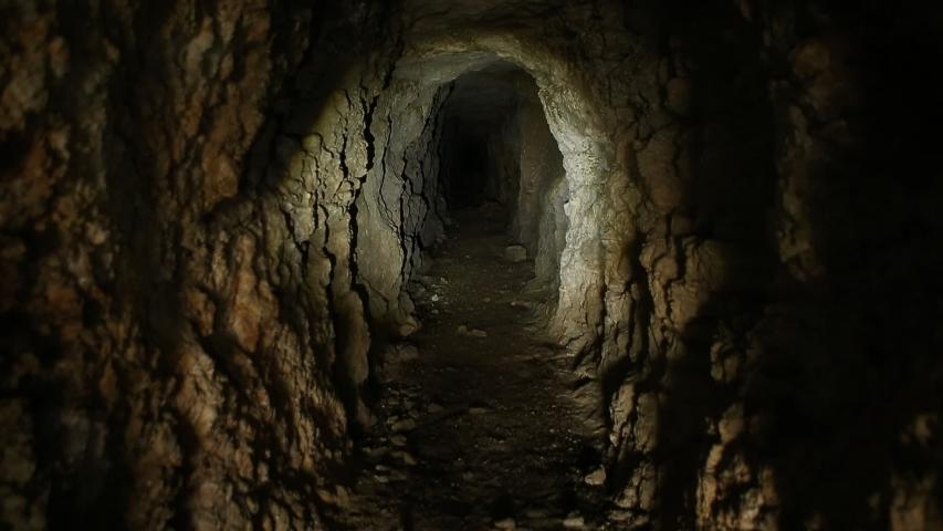 Flashlight or Torch on Walls of Abandoned Mine Tunnel.   Shutterstock HD Video #1044634642
