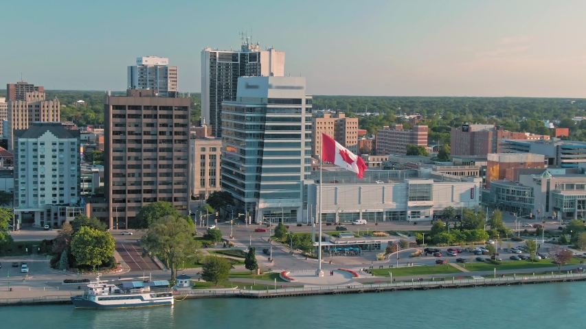 Aerial: Downtown Windsor and the Detroit River at sunset. Ontario, Canada