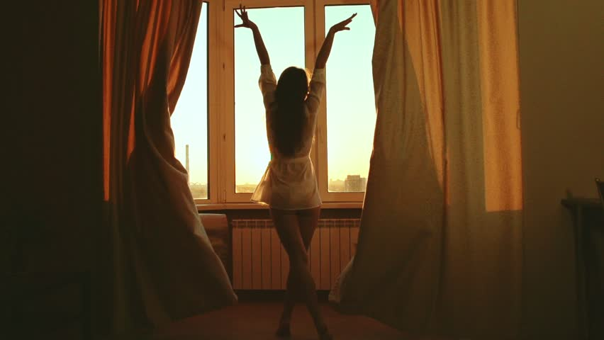 Woman in the morning. Attractive sexy woman with slender body opens curtains on big window and let the light in the room and has a perfect cozy morning. Slow motion #10446533