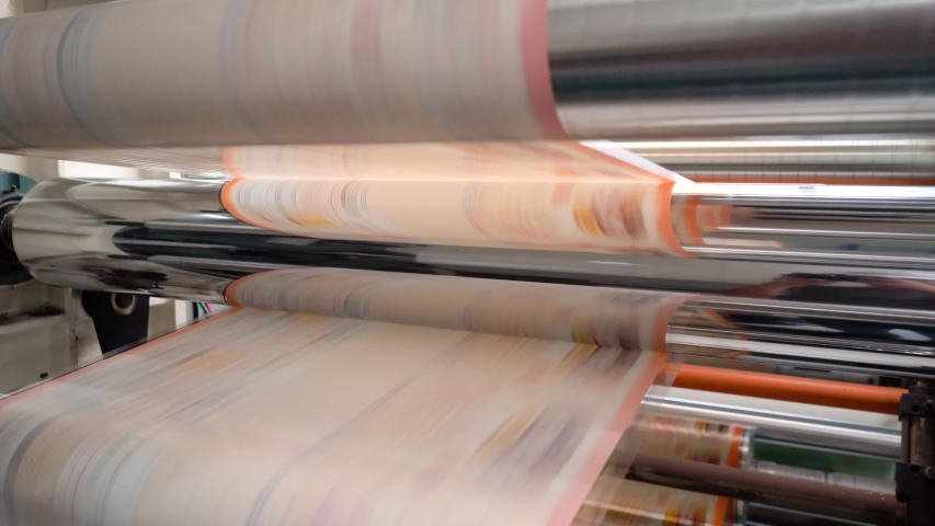 Rotogravure Printing method. It is one of the flexible packaging processes. The planned film was printed each color thru a cylinder. The machine is running in high speed mode.   | Shutterstock HD Video #1044662287
