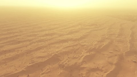 Aerial view of sand dunes in a hot desert in the United Arab Emirates