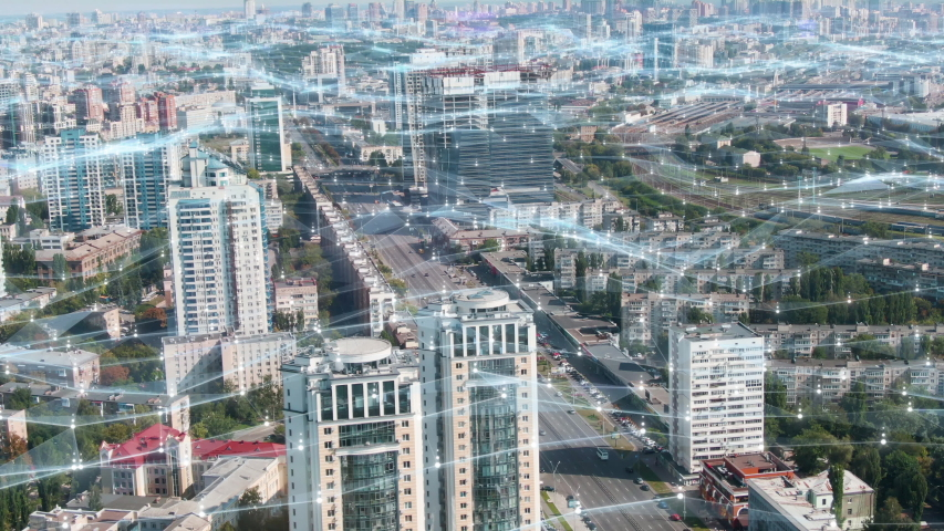 Modern City covered with Internet 5g Mobile Digital Technology. Aerial view of Kyiv Connected through Wireless Network. Plexus spreading data communication, cloud, AI, internet of things. Futuristic