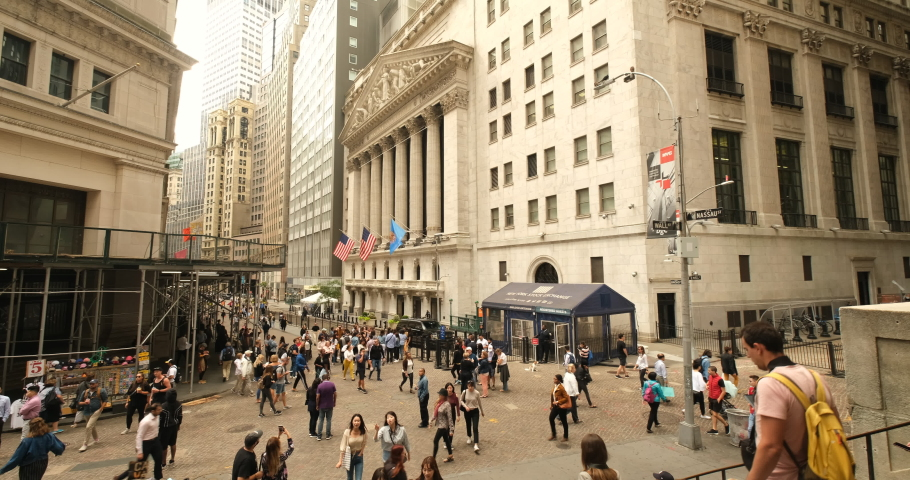 Manhattan, New York - September 18, 2019: People sit on the steps of Federal Hall by the New York Stock Exchange building in the financial district on Wall Street in lower Manhattan New York USA