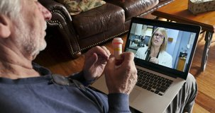 Elderly man talking to a woman doctor, nurse, physicians assistant or health care provider via telemedicine about his medication on a laptop computer