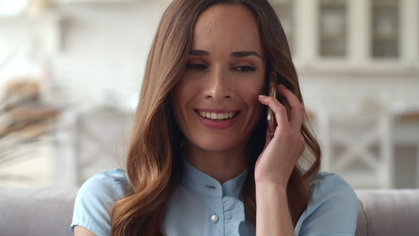 Focused business woman speaking mobile phone at home office in slow motion. Closeup smiling lady talking smartphone. Portrait of beautiful girl flirting on phone at home. Royalty-Free Stock Footage #1044824332