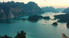Drone video on Lake Cheow Lan Lake, breathtaking views of the mountains of wildlife and the blue lake, Thailand, Phuket protected places, rainforests, a trip to Thailand with a drone.