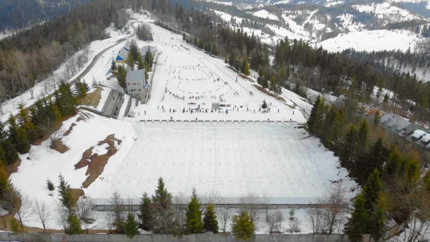 Aerial view Biathlon. Winter sports in the mountains. Cross country skiing in the Ukrainian Carpathians