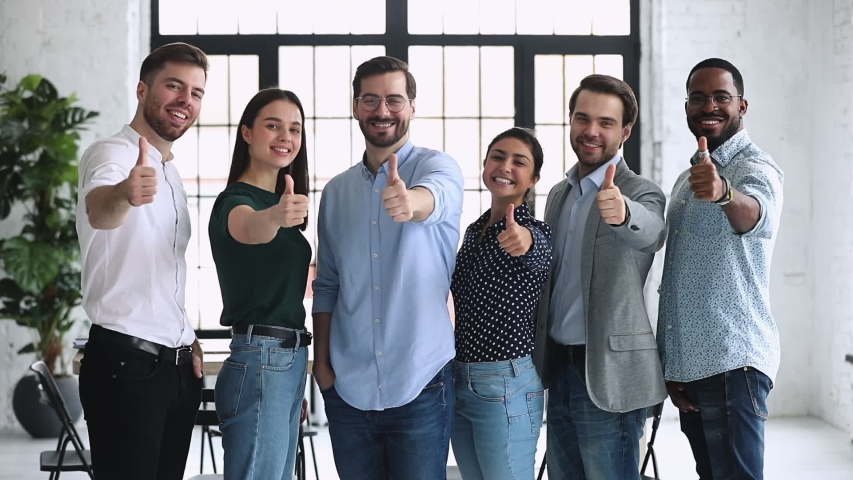 Happy proud professional diverse business people group show thumbs up look at camera stand in row in office, human resource recommend vote for best business choice concept, corporate team portrait