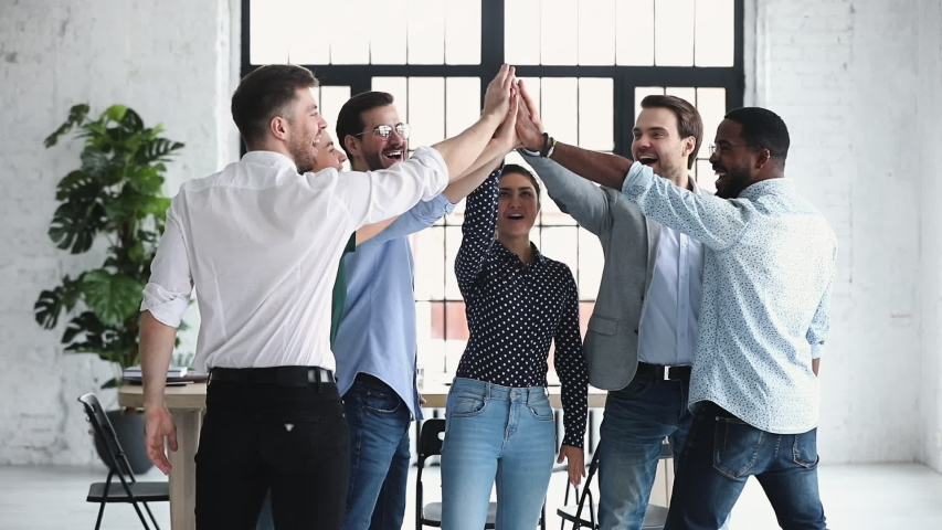 Happy diverse professional business office team give high five together in office, multiethnic coworkers group celebrate corporate success engaged in unity teamwork partnership concept, slow motion Royalty-Free Stock Footage #1044846448