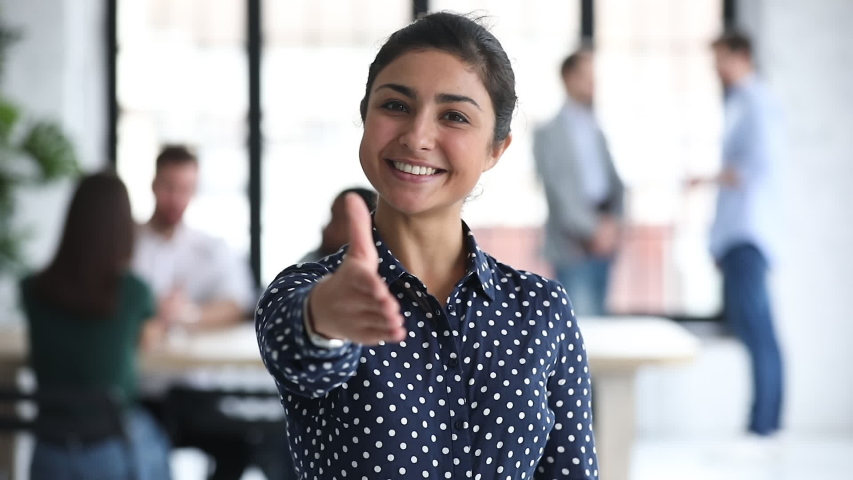 Smiling confident young professional indian ethnic business woman hr employer looking at camera extending hand for handshake offer collaboration in office, introduction concept, portrait, slow motion Royalty-Free Stock Footage #1044846475