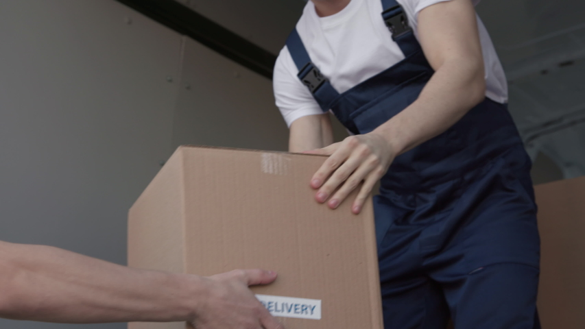 Professional Workers on Putting Boxes for Transportation Company. Concept of Trade Transit on Truck or Carriage on Van. Lifestyle of Smiling Man at Job of Piling Carton Packages at Lorry for Convey