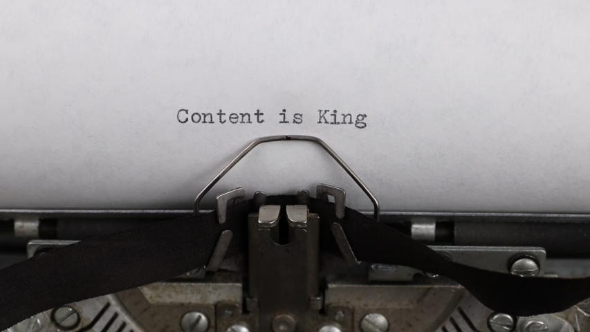 Close-up typing a text content is king, old vintage typewriter with a sheet of paper  | Shutterstock HD Video #1044861016