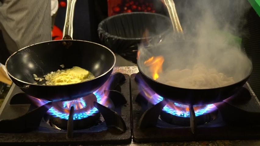 Chef Cooking Food In Wok On Open Fire | Shutterstock HD Video #1044881890