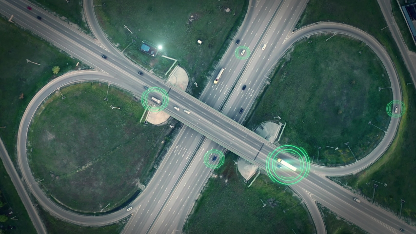 GPS navigation and autonomous driverless transportation concept. Aerial view of transport junction with cars and trucks driving with digital green circles, future global technology on roads Royalty-Free Stock Footage #1044892783