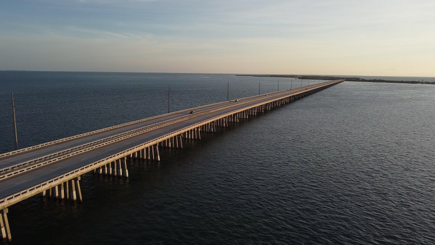 Aerial shot of cars driving on Overseas Highway on the way to at sunrise Key West, Florida   Shutterstock HD Video #1044926638