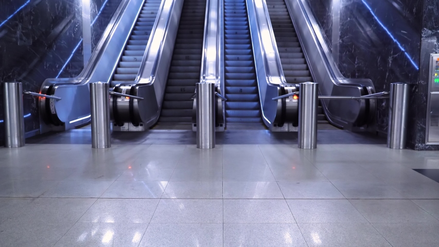 Large modern escalator in subway. Deserted escalator without people on four lanes that move up and down. Lines, light. Empty metro, no people. | Shutterstock HD Video #1044928075