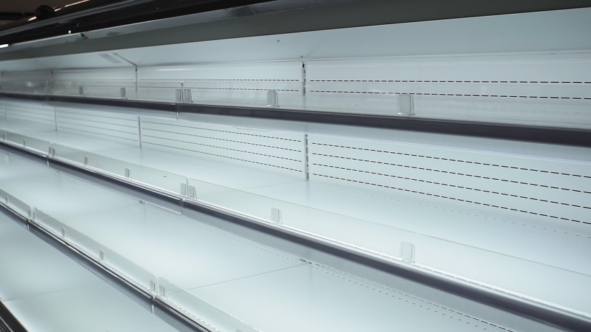 Empty white shelves in a store, supermarket | Shutterstock HD Video #1044960703